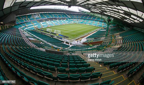 A general view of a rain soaked Celtic Park pitch before the UEFA Champions League qualifying round playoff first leg match between Celtic and Malmo...