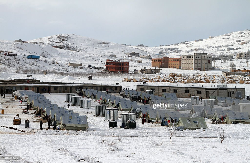 A general view of a refugee camp in the town of Arsal in the Lebanese Bekaa valley on December 13, 2013. Thousands of Syrian refugees living in makeshift camps in Lebanon were weathered a winter storm that brought snow, rain and freezing temperatures to the country.