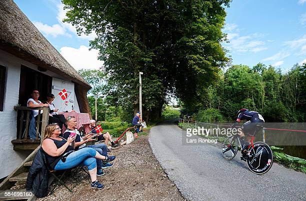 General view of a rider passing a lake and an old country house during stage four at the Postnord Danmark Rundt race time trial in Nyborg on July 30...