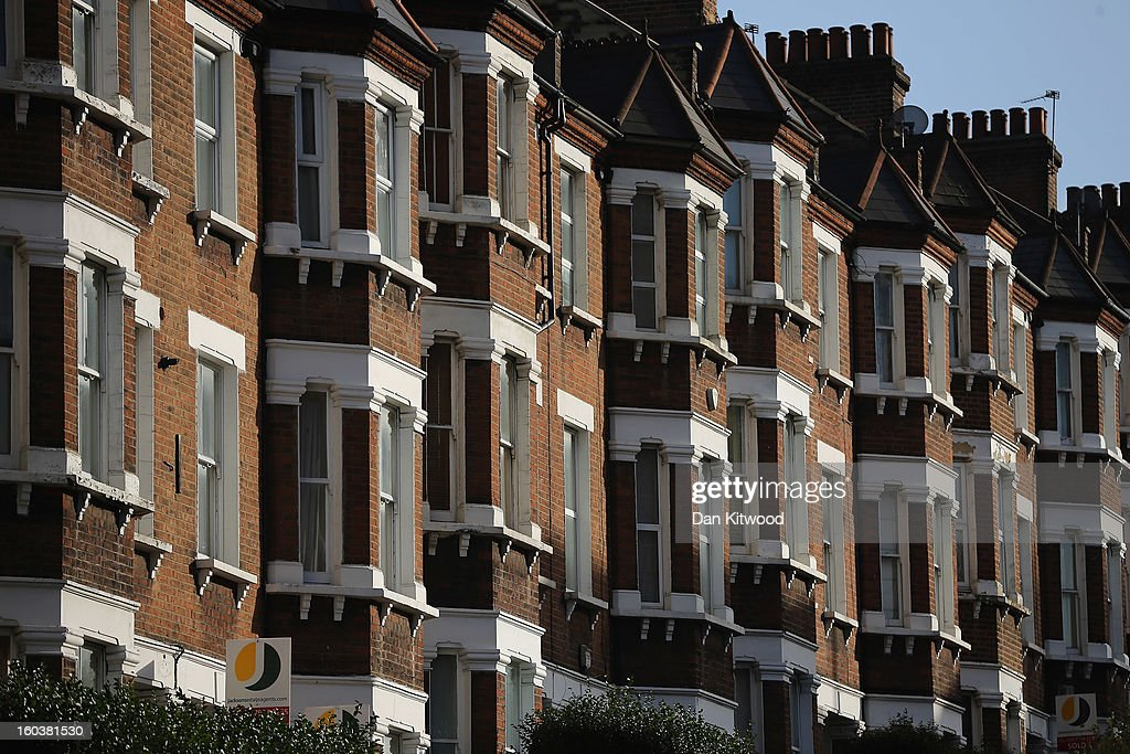 A general view of a row of houses near Battersea on January 30, 2013 in London, England. According to a report from independent analysts Oxford Economics, the average mortgage deposit for first-time buyers in London, is likely to exceed £100,000 GBP by 2020.