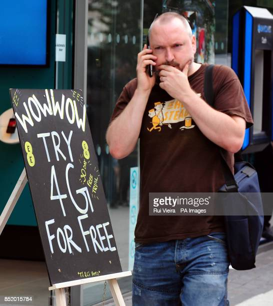 General view of a sandwich board promoting 4G network service outside an EE phone shop in Birmingham