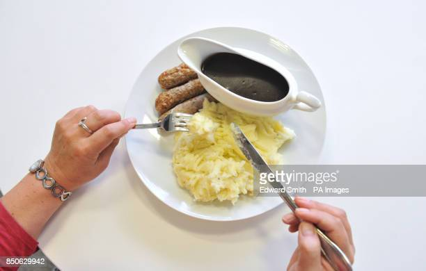 General view of a sausage and mash dinner