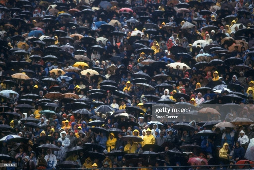 General view of a sea of umbrellas as supporters shelter from the rain during the Italian League match between Napoli and A C Milan in Italy The...