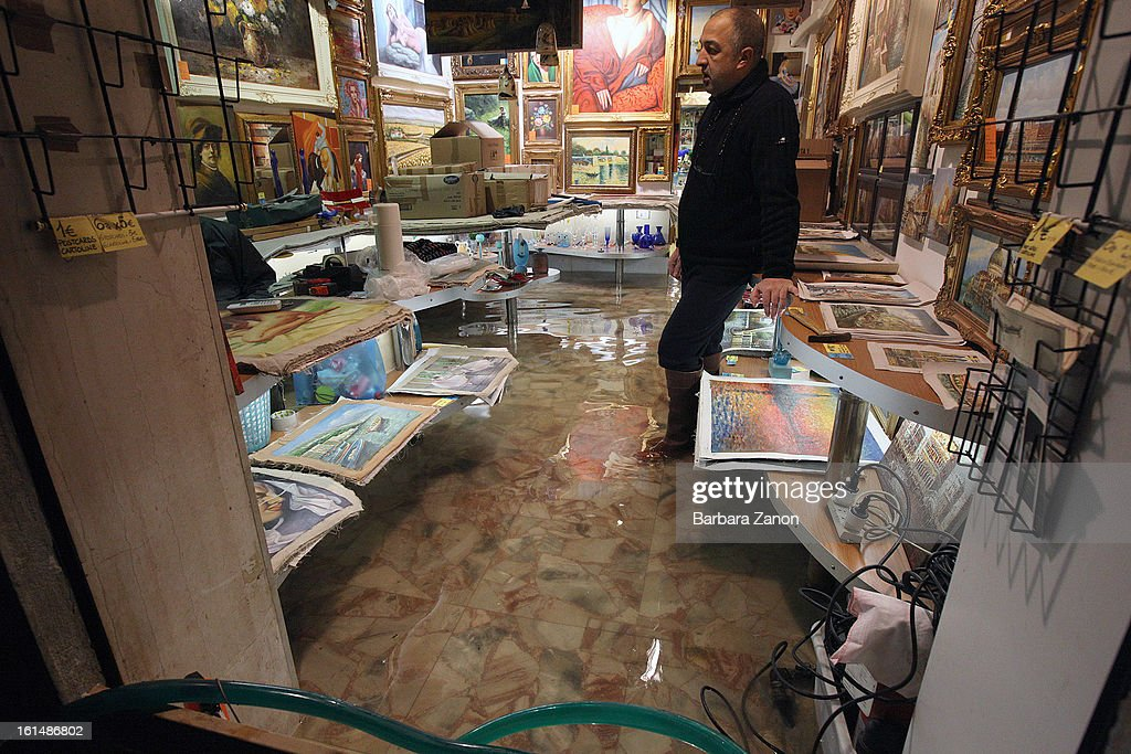 General view of a shop during a heavy snow and high tide on February 11, 2013 in Venice, Italy. Heavy snow, high water, rain and wind hit the city today and sea level rose to 145cm.
