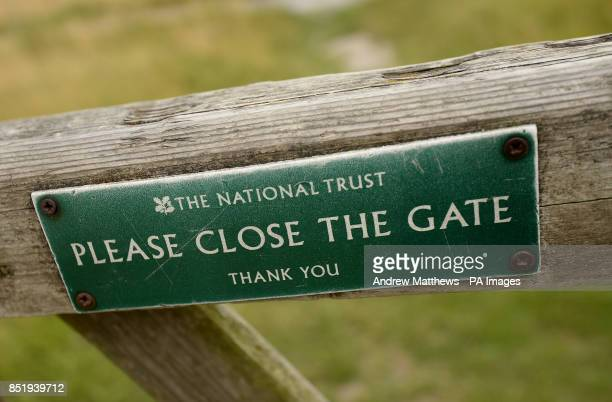 General view of a sign by The National Trust asking members of the public to Please Close The Gate on Uffington White Horse Hill Oxfordshire