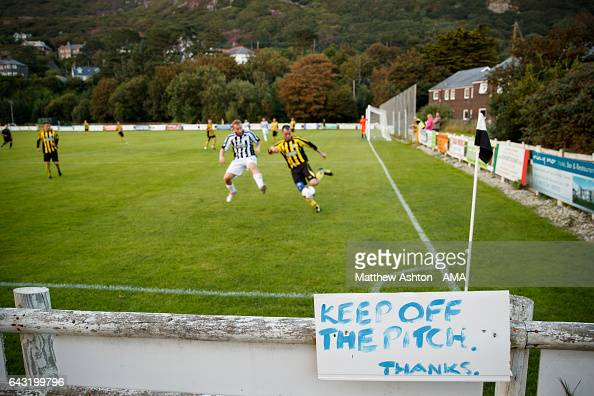 A general view of a sign saying Keep off the pitch at Barmouth Dyffryn United Football Club a Welsh football club based in the coastal town of...