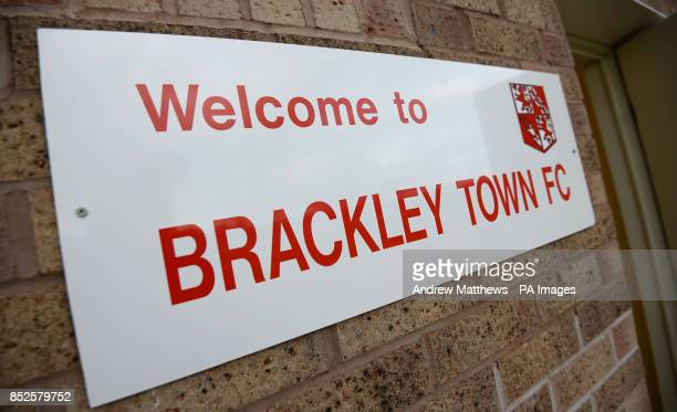 General view of a sign welcoming people to Brackley Town FC on a wall at St James Park home to Brackley Town