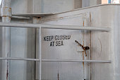 A general view of a sign which reads KEEP CLOSED AT SEA on oard the Wightlink ferry crossing the Solent on July 23 2016 in Portsmouth England