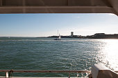 A general view of a small sail boat on the Solent close to Portsmouth harbour from the Wightlink ferry traveling from the Isle of Wight on July 23...