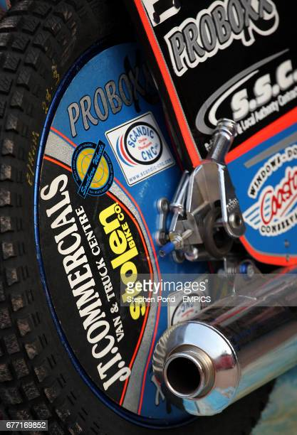 General view of a Speedway motorbike's back wheel and exhaust pipe