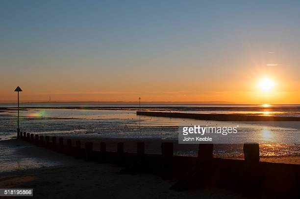 A general view of a sunset over the Thames Estuary with silhouetted sea defences on January 19 2016 in Southend on Sea England