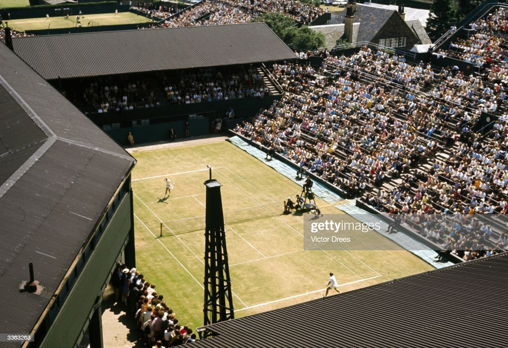 A general view of a tennis match in progress on the Number One Court at Wimbledon.
