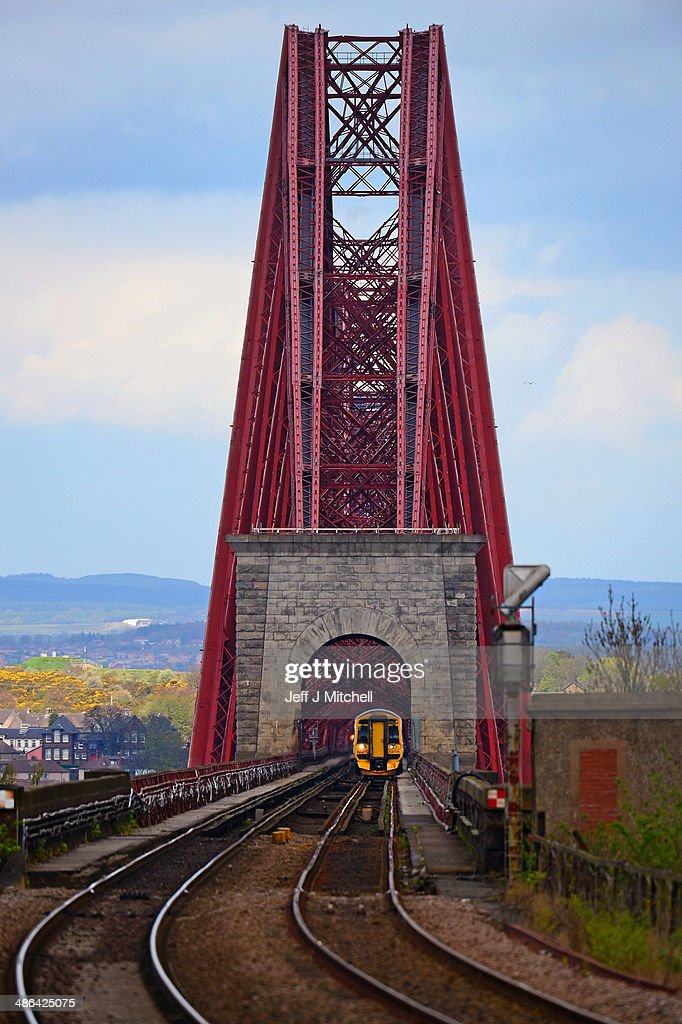 A general view of a train crossing the Forth Rail Bridge on April 24, 2014 in South Queensferry, Scotland. A referendum on whether Scotland should be an independent country will take place on September 18, 2014.