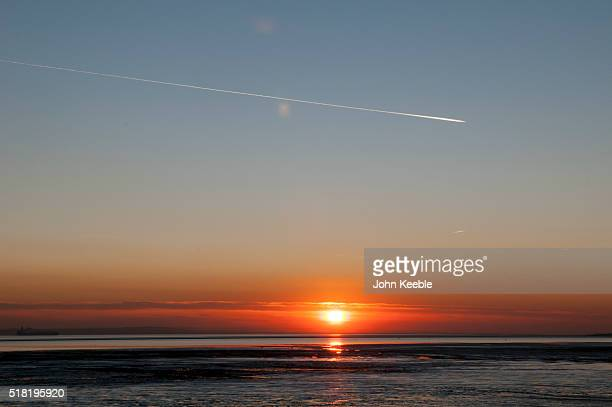 A general view of a vapour trail from an aircraft as the sunsets over the Thames Estuary on January January 19 2016 in Southend on Sea England