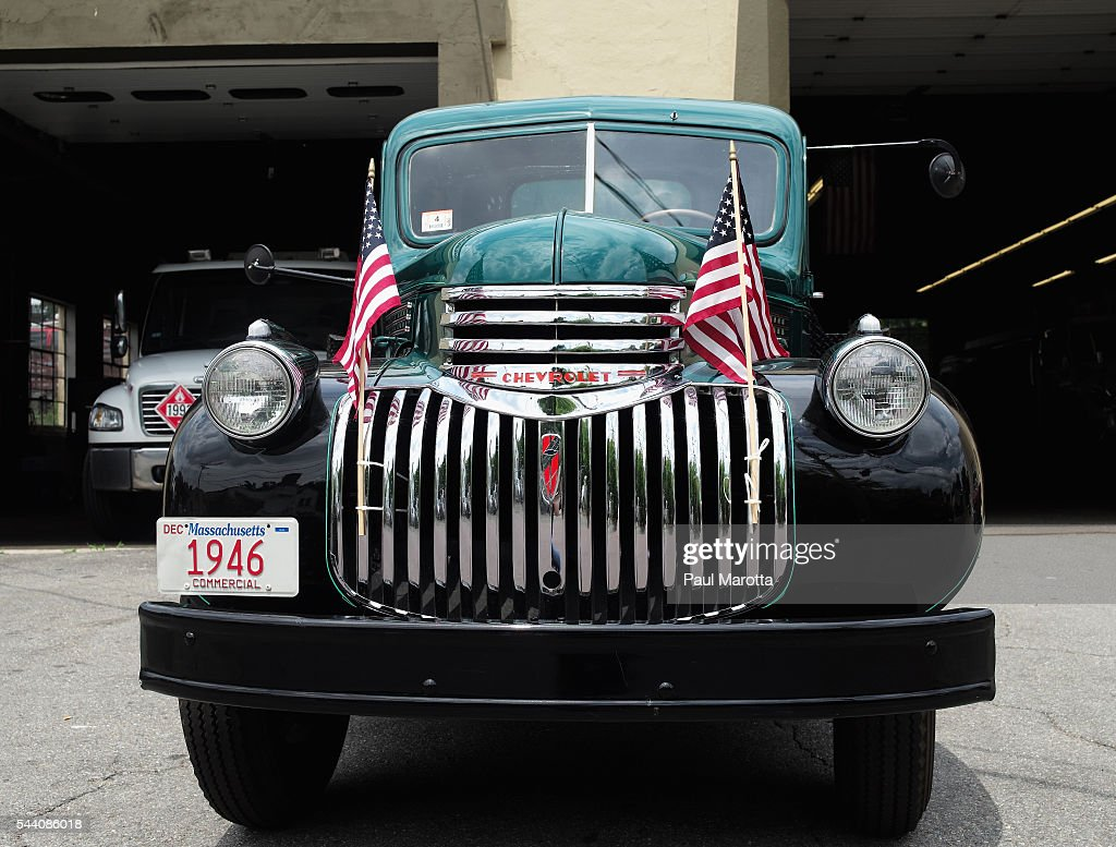 A general view of a vintage fuel oil delivery truck decorated with American flags for Fourth of July on July 1, 2016 in Boston, Massachusetts.