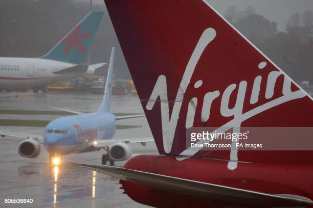 General view of a Virgin aeroplane tail fin at Manchester Airport