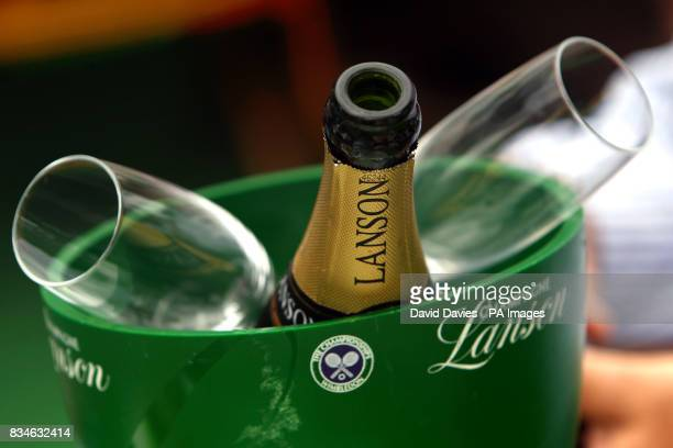 A General view of a Wimbledon ice bucket with an opened bottle of Lanson Champagne and two flute glasses