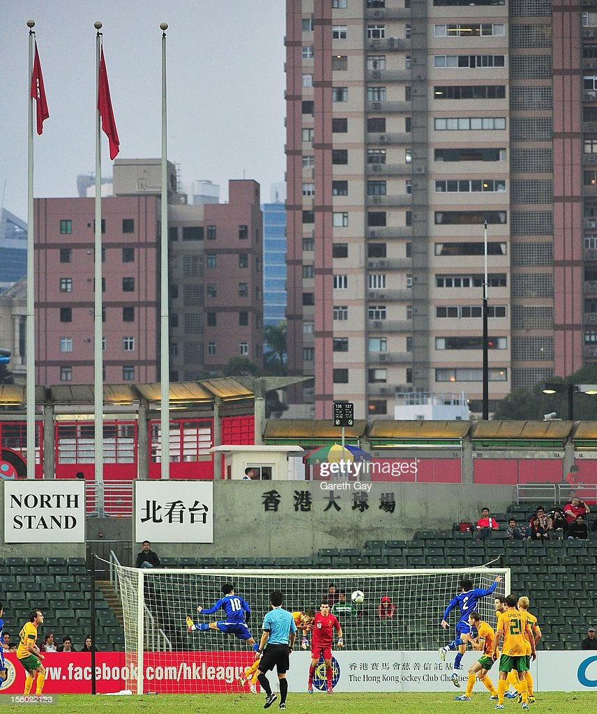 A general view of action as Chen Hao Wei (2nd L) of Chinese Tapei looks to win the ball in the air during the EAFF East Asian Cup 2013 Qualifying match between Chinese Tapei and the Australian Socceroos at Hong Kong Stadium on December 9, 2012 in So Kon Po, Hong Kong.