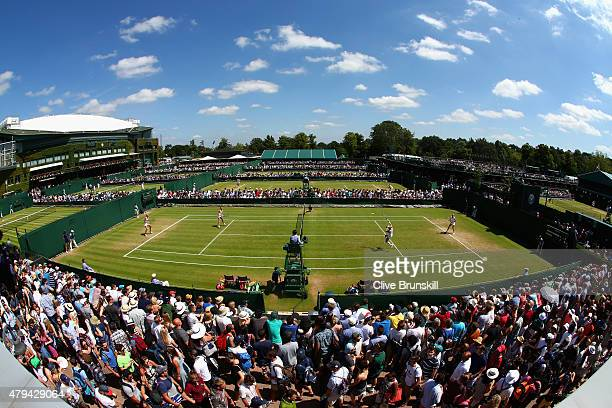A general view of action on court 8 during day six of the Wimbledon Lawn Tennis Championships at the All England Lawn Tennis and Croquet Club on July...
