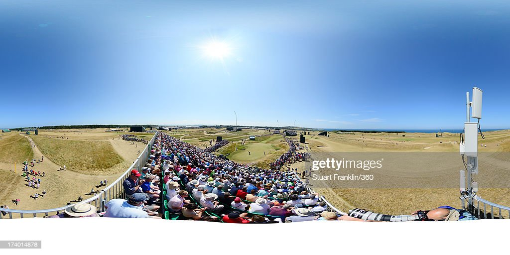 A general view of action on the 13th green as spectators look on during the second round of the 142nd Open Championship at Muirfield on July 19, 2013 in Gullane, Scotland.