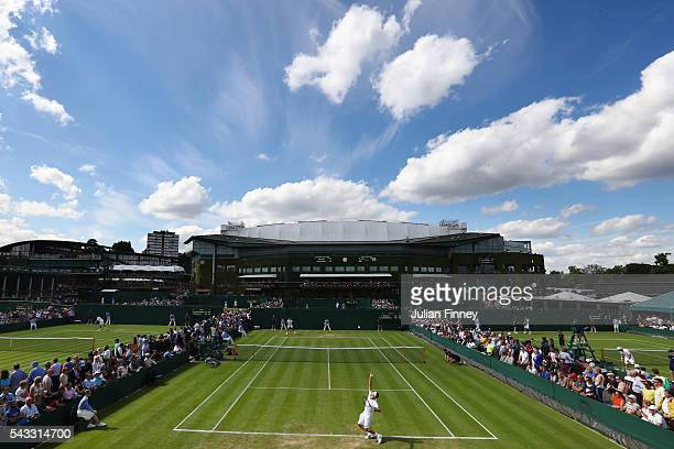 A general view of action the outside courts on day one of the Wimbledon Lawn Tennis Championships at the All England Lawn Tennis and Croquet Club on...