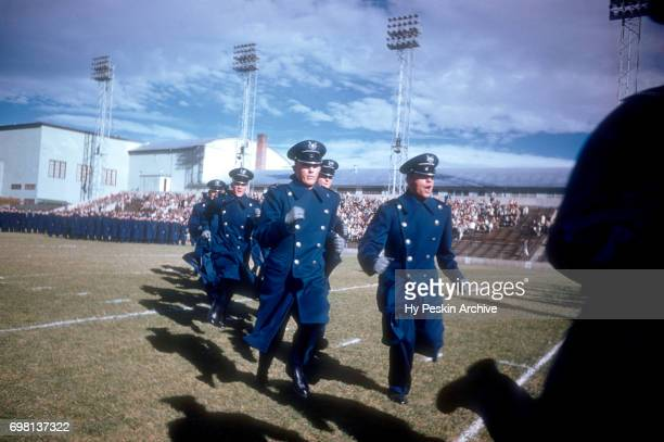 General view of Air Force cadets run on the field prior to the game against the Denver Pioneers on November 8 1958 at DU Stadium in Denver Colorado