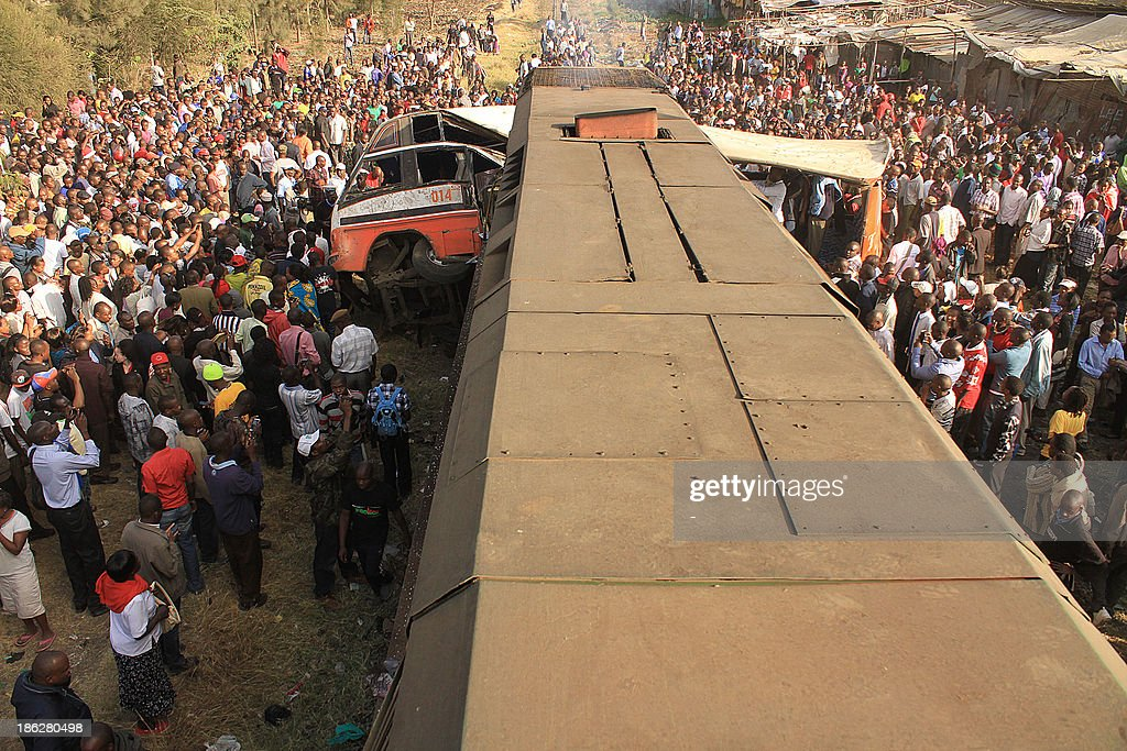 A general view of an accident scene where a train rammed into a public service bus October 30, 2013 at a crossing point killing at least 12 passengers of the bus. The train crashed into the side of the bus as it crossed the railway line during the peak hours of morning rush hour, local police commander Benjamin Nyamae said. AFP PHOTO/Stringer