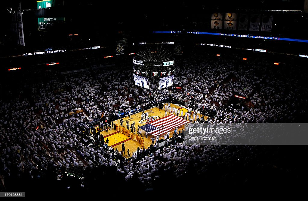 A general view of an American Flag stretched across the court during the performance of the National ANthem between the Miami Heat and the Indiana Pacers during Game Seven of the Eastern Conference Finals of the 2013 NBA Playoffs at AmericanAirlines Arena on June 3, 2013 in Miami, Florida.