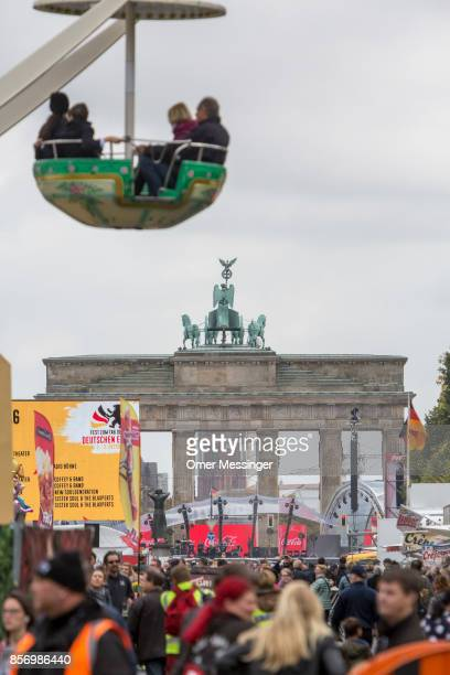 A general view of an amusement area set up along 17th of June Street in Tiergarten Park near tthe Brandenburg Gate on German Unity Day on October 3...