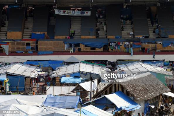 A general view of an overcrowded sports complex that has been used as a refuge facility for civilians displaced since September 9 2013 following an...