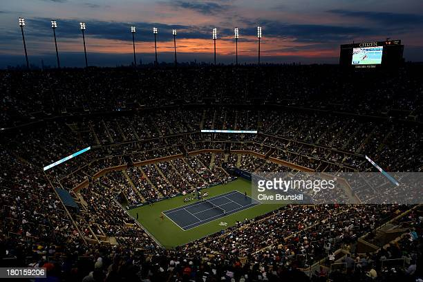 A general view of Arthur Ashe Stadium at sunset as Novak Djokovic of Serbia plays a forehand during his men's singles final match against Rafael...