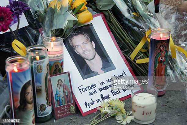 A general view of atmosphere as fans pay tribute to actor Paul Walker at the site of his fatal car accident on December 1 2013 in Valencia California...