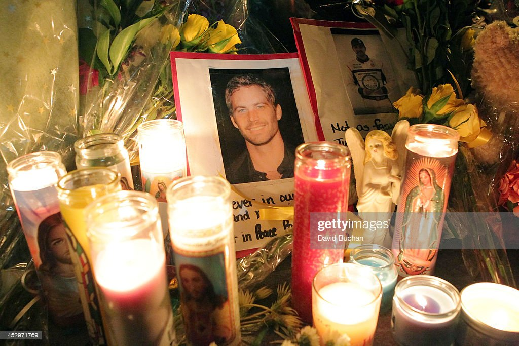 A general view of atmosphere as fans pay tribute to actor Paul Walker at crash site on December 1, 2013 in Valencia, California.