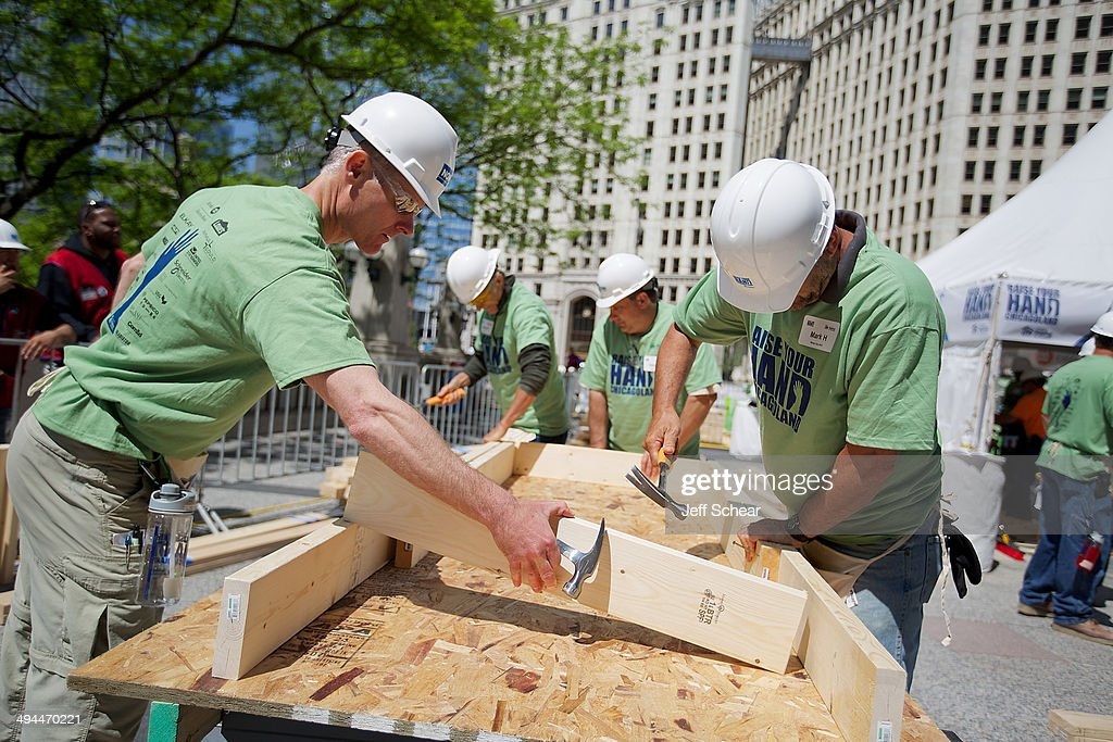 A general view of atmosphere at Habitat for Humanity's 'Raise Your Hand Chicagoland,' an unprecedented building blitz in the heart of downtown Chicago, kicked off today, with wall frames built for Habitat homes in Chicago's West Pullman neighborhood. From May 29 through June 1 at Pioneer Court Plaza, volunteers will come together with partner families to complete the initial construction of 13 homes. Immediately following, these new homes will be taken into communities across the region, where they will be finished and become a place 13 families can call their own. Those across the area are invited to attend 'Raise Your Hand Chicagoland' to tour a Habitat home, participate in family-friendly activities and learn more about Habitat for Humanity in Chicagoland, including future volunteer opportunities. Chicagoans can also show their support virtually using #RYHC and following Habitat for Humanity on Facebook, Twitter and Instagram (@ChicagoHabitat). For more information, visit chicagolandhabitat.org/RYHC.