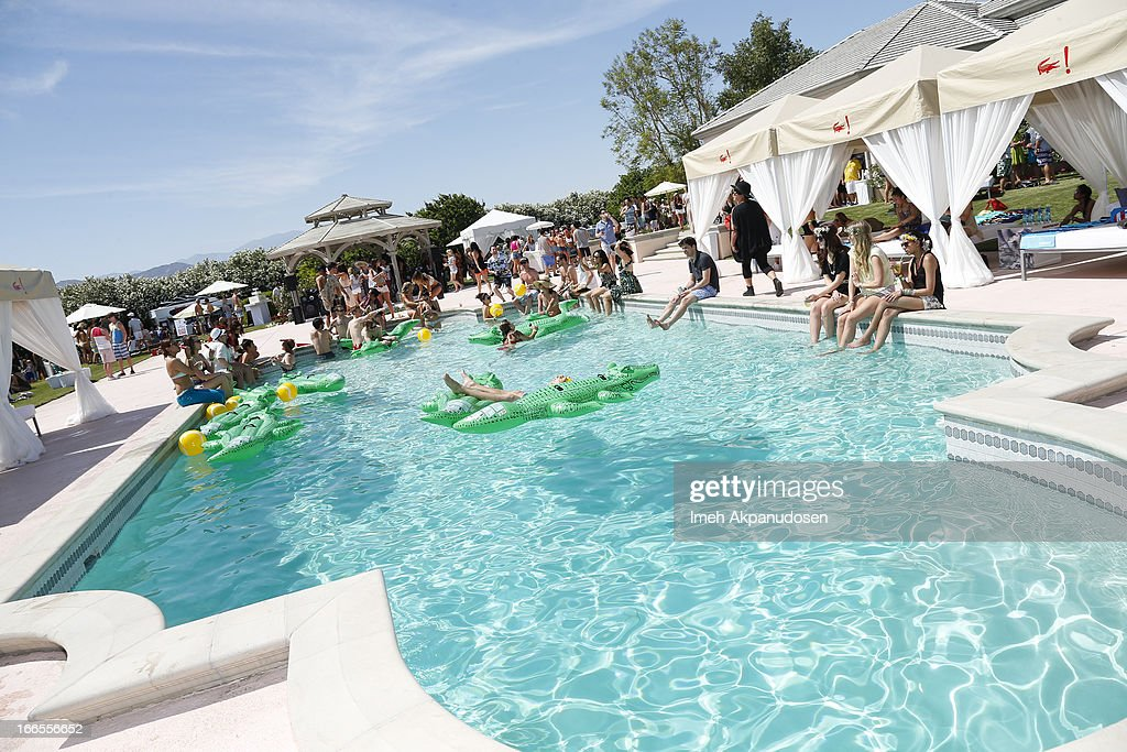 A general view of atmosphere during the FIJI Water At Lacoste LVE Coachella Desert Pool Party on April 13 2013 in Palm Springs California