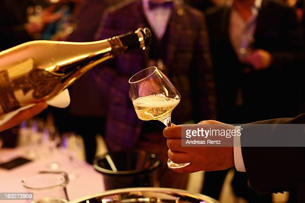 A general view of atmosphere is pictured at Armand de Brignac champagne tasting at the French embassy to Germany on March 6 2013 in Berlin Germany...