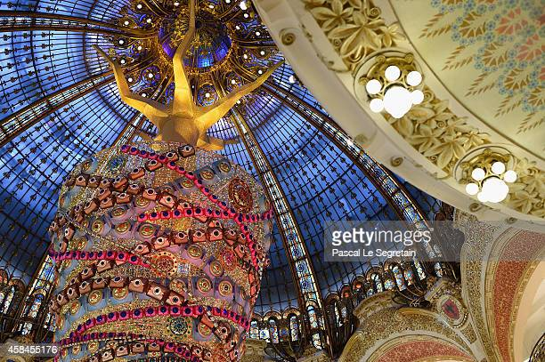 General view of atmosphere is seen during the Christmas decorations inauguration at Galeries Lafayette on November 5 2014 in Paris France