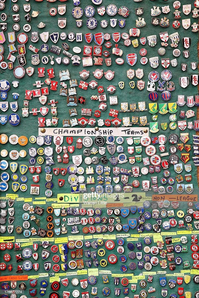 A general view of badges on a merchandise stall ahead of the Barclays Premier League match between West Ham United and Cardiff City at Boleyn Ground on August 17, 2013 in London, England.