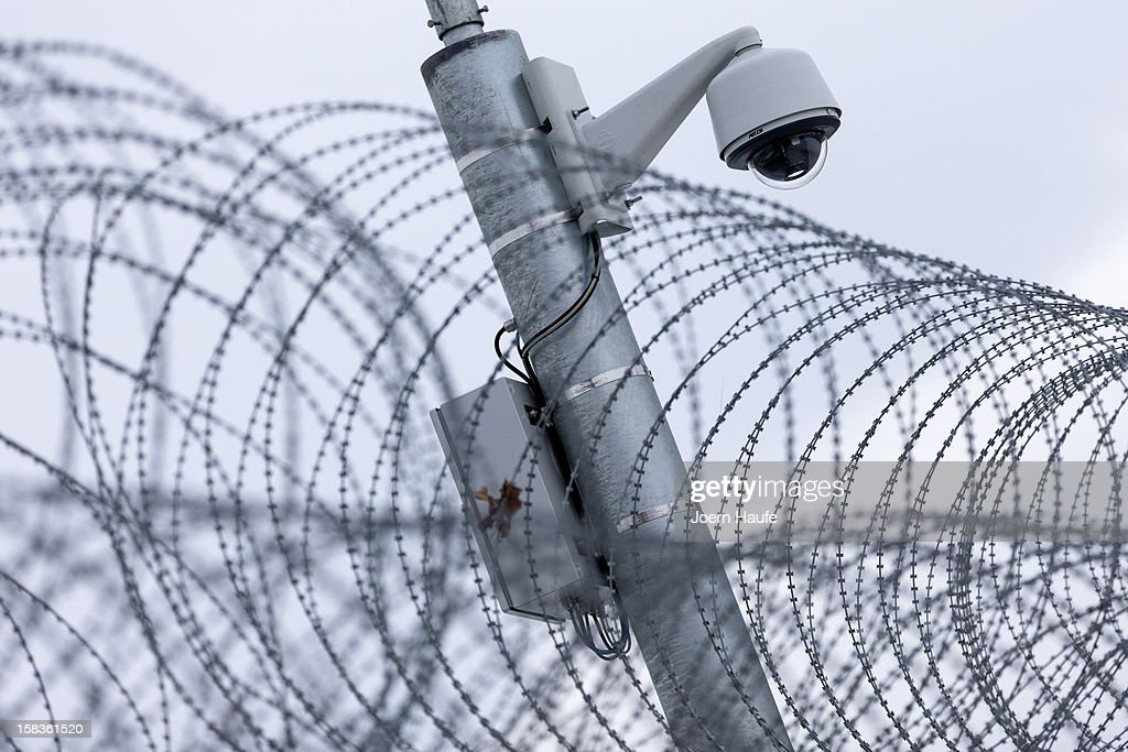 A general view of barbed wire fencing and a security camera at the JVA Bautzen prison on December 14, 2012 in Bautzen, Germany. One of the detention houses at the prison has been marked for transformation into a preventive detention facility with construction due for completion in 2013. A new law passed this year clarifies the ability of the state to transfer convicted criminals who have served their sentences yet are still deemed as potentially dangerous to society to preventive detention facilities.