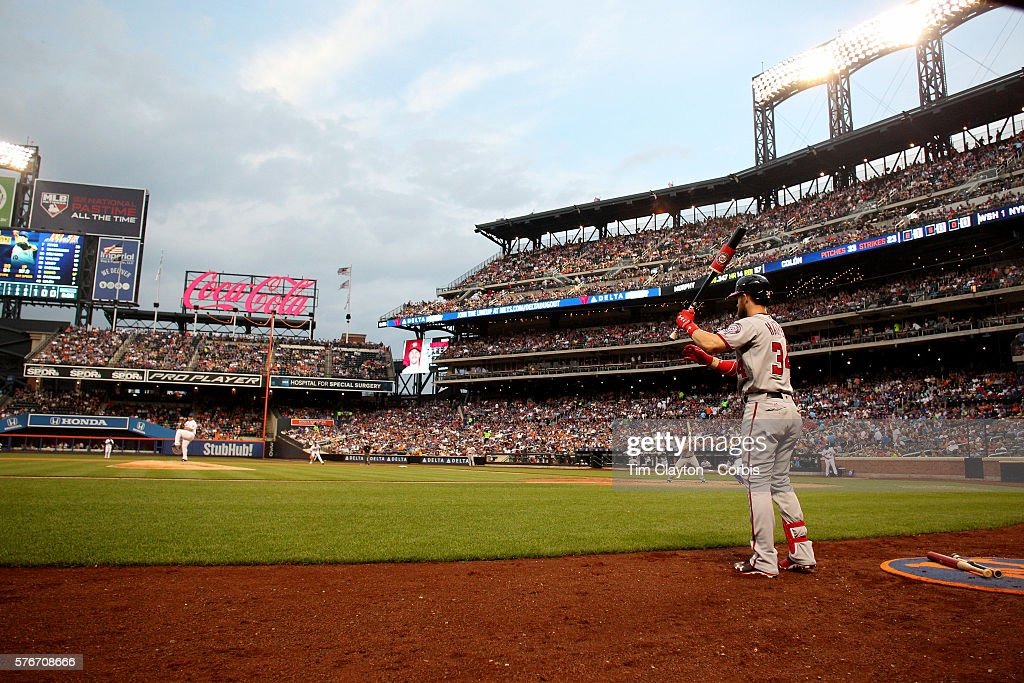 A general view of Bartolo Colon of the New York Mets pitching to Daniel Murphy of the Washington Nationals as Bryce Harper of the Washington...