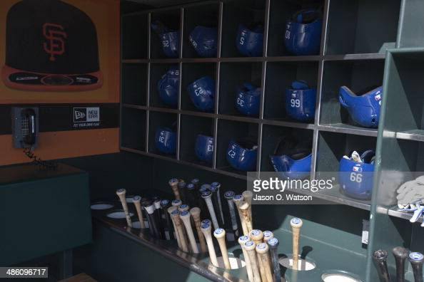 General view of batting helmets and baseball bats in the Los Angeles Dodgers dugout before the game against the San Francisco Giants at ATT Park on...