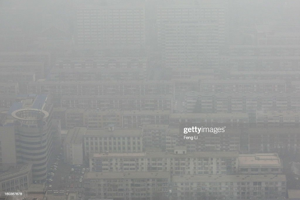 A general view of Beijing city during severe pollution on January 30, 2013 in Beijing, China. The fourth round of heavy smog to hit Beijing in one month has sent more people to the hospital with respiratory illnesses and prompted calls for legislation to curb pollution. The haze choking many Chinese cities covers a total area of 1.3 million square kilometers, the China's Ministry of Environmental Protection said Tuesday.