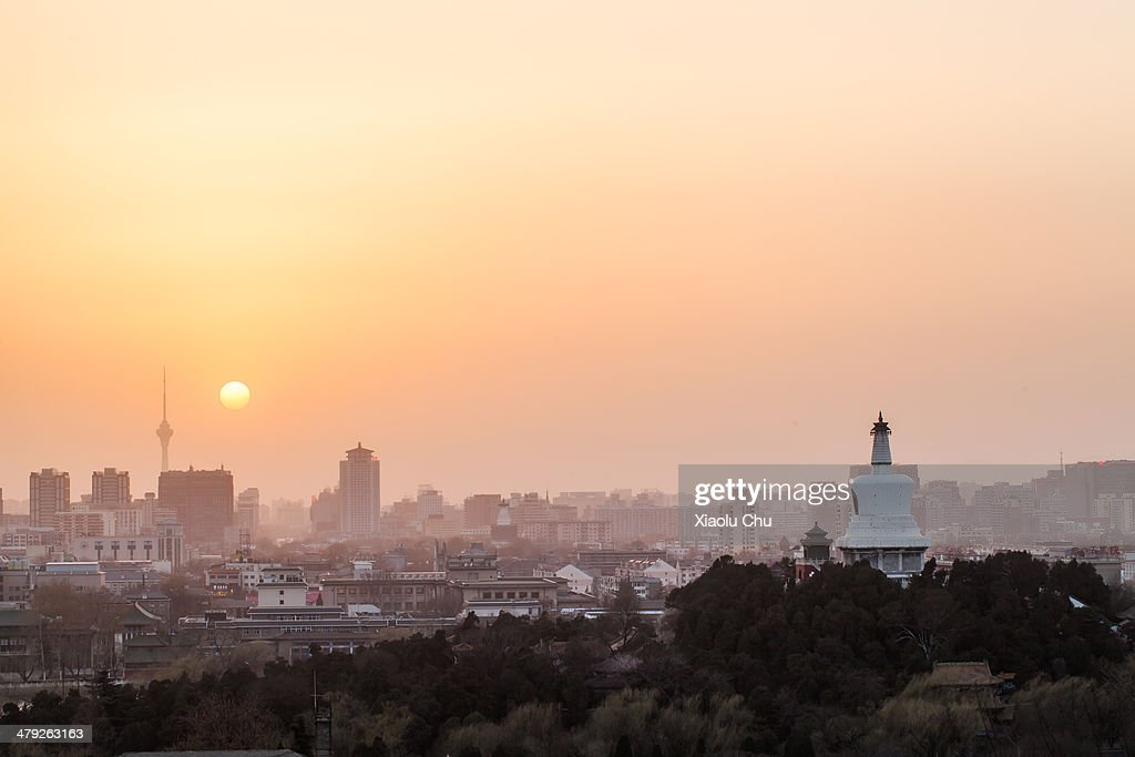 A general view of Beijing skyline at sunset as winds dissipate some of the smog on March 17, 2014 in Beijing, China. China is vowing to ammend its procedures to curb pollution as smog in some areas of China have registered over 20 times the level considered safe by the World Health Organization (WHO).