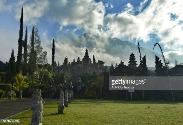 A General view of Besaki tempel before people arrive to pray for Mount Agung during Purnama ceremony as Mount Agung is seen obscured by clouds in the...