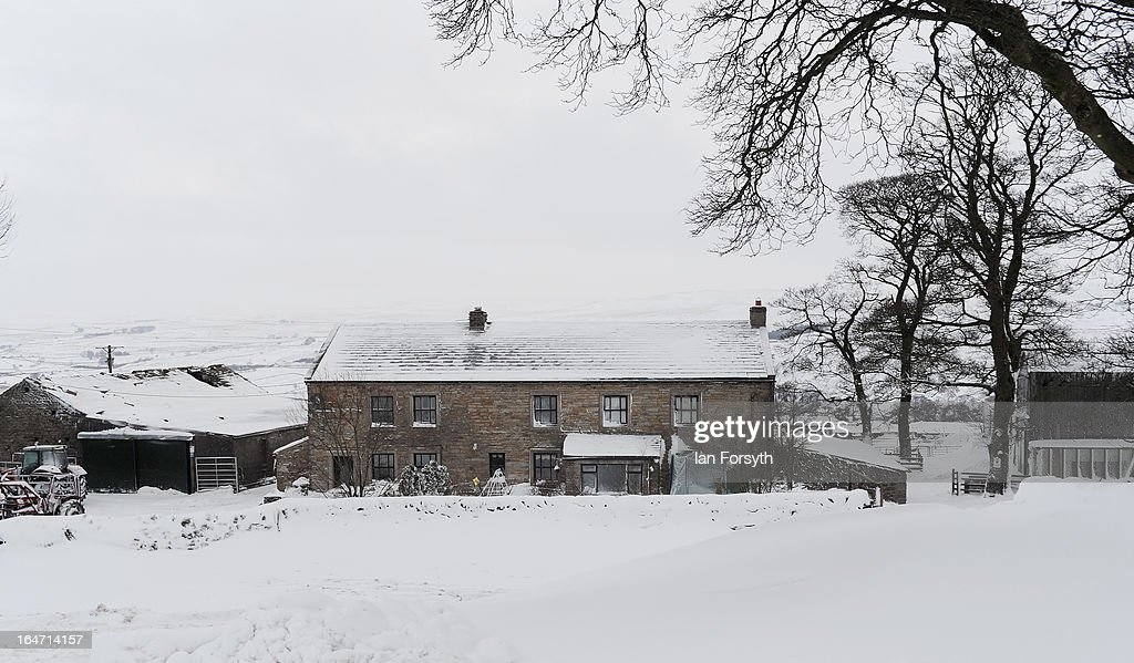 A general view of Bleathgill Farm in the hamlet of Barras following heavy snow on March 27, 2013 near Kirkby Stephen, Cumbria, England. Stuart Buckle, 23, runs Bleathgill Farm with his father Wilf and as heavy snow continues to fall, extra effort is needed to look after and protect their Swaledale sheep from the cold. Across the UK, farmers are battling to save livestock after heavy snow and freezing temperatures has left thousands of sheep and cattle stuck in the fields with no access to food and fresh water.