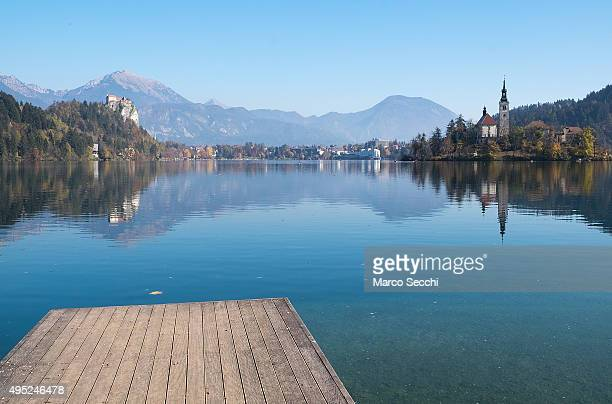 A general view of Bled island with its 17thcentury church and Bled Castle on November 1 2015 in Bled Slovenia Bled Lake in the Julian Alps is known...