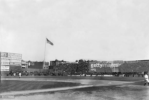 General view of Boston's Fenway Park home of the American League baseball team the Boston Red Sox shows stands full of fans early 20th Century