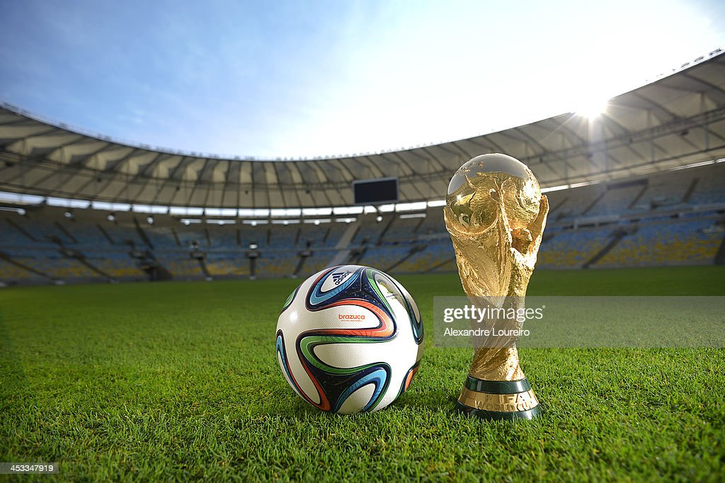 A general view of Brazuca and the FIFA World Cup Trophy at the Maracana before the adidas Brazuca launch at Parque Lage on December 3, 2013 in Rio de Janeiro, Brazil. Brazuca is the Official Match Ball for the FIFA World Cup 2014 Brazil. Tonight adidas revealed brazuca to the world in the stunning setting of Parque Lage in Rio de Janeiro. The reveal was part of a spectacular light projection supported by global footballers Seedorf, Hernane and FIFA World Cup Winner Cafu. Hundreds of guests and celebrities were treated to this one off experience, which launched the Official FIFA World Cup Ball for Brazil 2014. For more information visit: news.adidas.com/worldcupOMB