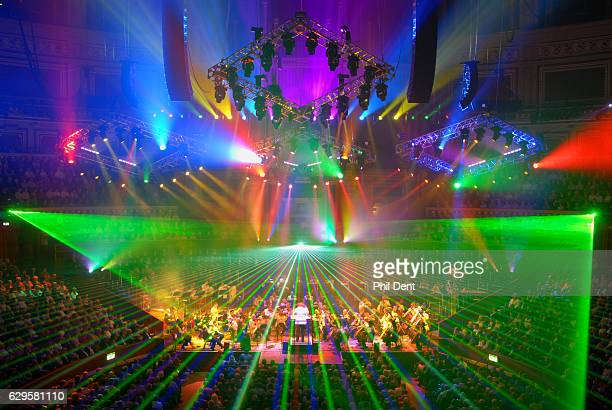 General view of brightly coloured laser style lighting over an orchestra performing in London 2009