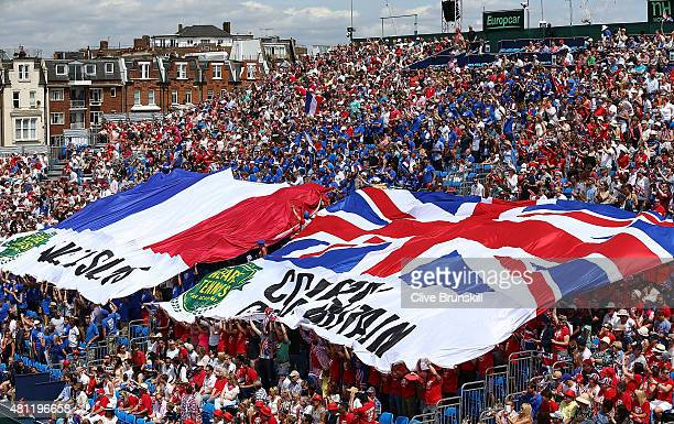 General view of British fans holding Union Jack flag during Day Two of the World Group Quarter Final Davis Cup match between Great Britain and France...